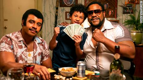 "Joseph Lee Anderson as Rocky Johnson, Adrian Groulx as Dwayne and Nate Jackson as Junkyard Dog appear in a scene from ""Young Rock.&인용;"