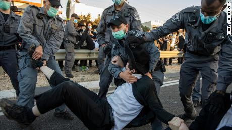 Israeli police clear ultra-Orthodox Jews blocking a highway in a protest in Bnei Brak on December 27, 2020, against the detention of a member of their community who refused to do military service.