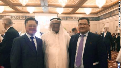North Korea's former acting ambassador to Kuwait Ryu Hyeon-woo. CNN blurred the faces of the others in this picture to protect them from possible reprisals.