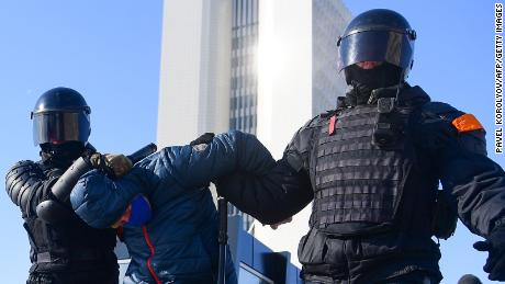 Riot police detain a man during a rally in support of jailed opposition leader Alexey Navalny in the far eastern city of Vladivostok on Sunday.