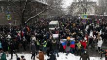 People attend a protest in Moscow on Sunday against the jailing of Alexey Navalny.