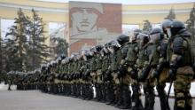 Police block the way during a protest against the detention of Navalny in Volgograd, Russia, on Sunday.