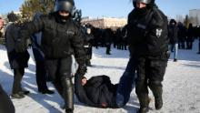 Police detain a man during a protest in support of Navalny in the Siberian city of Omsk on Sunday.