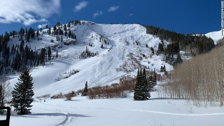 Rescuers are searching for a skier buried by an avalanche in Utah
