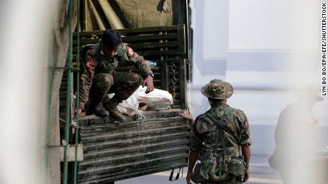 Military soldiers move bags from a truck into Yangon City Hall, in Yangon, Myanmar,  February 1, 2021.