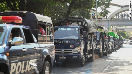Police forces are pictured in a line of trucks in the downtown area of Yangon on February 1, 2021, as Myanmar's military took power in a coup.