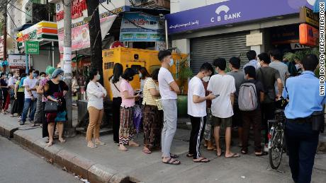 Residents in Yangon line up in front of an ATM machine of a closed bank on February 1, 2021.