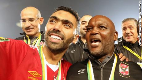 Al-Ahly player Hussein El Shahat (L) and head coach Pitso Mosimane (R) celebrate after winning the CAF Champions League final soccer match Zamalek vs Al-Ahly at Cairo International Stadium in Cairo, Egypt, 27 November 2020.