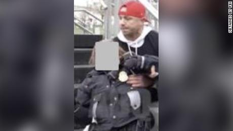 Ryan Stephen Samsel has been charged in connection with the January 6 US Capitol riot. Investigators cited this image as depicting Samsel. The officer's face has been obscured by prosecutors