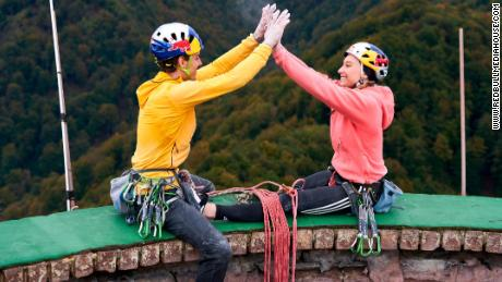 Janja Garnbret and Domen Škofic celebrate their ascent on top of the Trbovlje Chimney.
