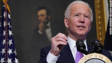 Biden tells House Democrats to 'stick together' in Covid-19 relief push