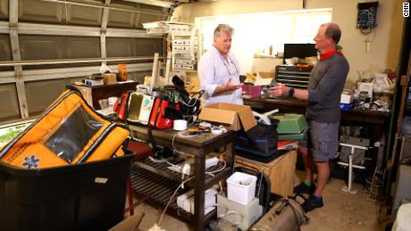SAVE-P founder Justin Corbett (left) and ventilator technician Robin Whittle (right) in Whittle's garage in Durban, South Africa.