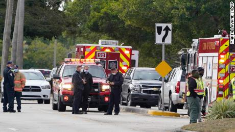 Law enforcement officers block an area where a shooting killed two FBI agents on Tuesday in Sunrise, Florida.