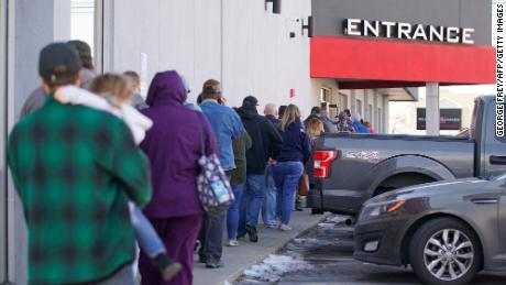 People line up to buy guns and ammunition at the Ready Gunner gun store on January 10, 2021 in Orem, Utah.