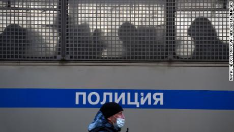 Silhouettes of detained people are seen in a police truck near the Moscow City Court.