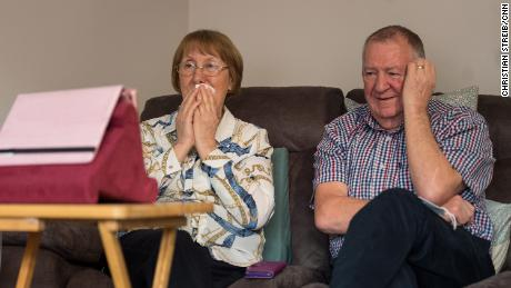 Trish Skinner sits with her husband Peter at home in Northamptonshire as they watch her father's burial service over Zoom.