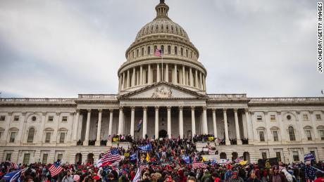 A pro-Trump mob stormed the Capitol, breaking windows and clashing with police officers on January 6, 2021.