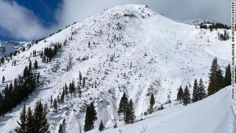 Looking across at the avalanche that caught four skiers on February 1, 2021. Their ski tracks are visible to the right of the avalanche, but where they entered into the gully is obscured by trees. Further to the right you can see a second, smaller avalanche, that released sympathetically to the first.