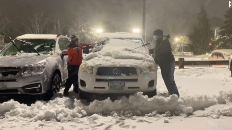 A 10-year-old boy and family friend cleaned snow off 80 hospital workers' cars during storm