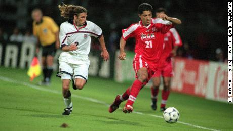 Iran's Minavand (right) in action vs. USA's Frankie Hejduk (left) in 1998 in Lyon, France.