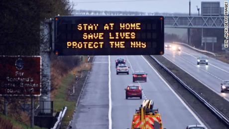 """An illuminated motorway sign carries the """"Stay At Home"""" message, on January 10 in Dunfermline, Scotland."""