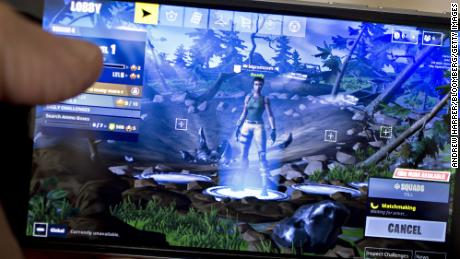 The Epic Games Inc. Fortnite: Battle Royale video game is displayed for a photograph on an Apple Inc. iPhone in Washington, D.C., U.S., on Thursday, May 10, 2018. Fortnite, the hit game that's denting the stock prices of video-game makers after signing up 45 million players, didn't really take off until it became free and a free-for-all.