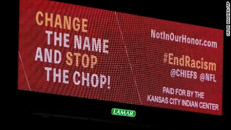 "A billboard calling the Kansas City Chiefs to change their name and end the ""chop&인용; stands along Interstate 70 in Missouri on February 3, 2021."