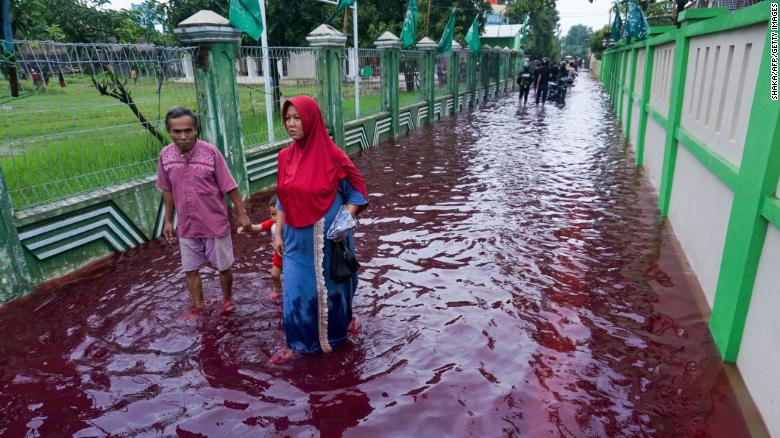 Indonesian village turns red as floods hit batik-manufacturing hub