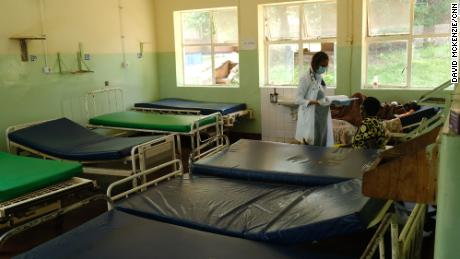 Dr. Tamara Phiri consults with a patient in a general ward.