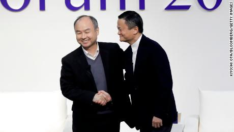 Masayoshi Son and Jack Ma shaking hands at a forum in Tokyo in 2019.