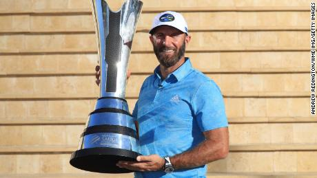 Johnson poses with the trophy after winning the Saudi International.