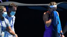 Victoria Azarenka leaves the court to receive medical attention.