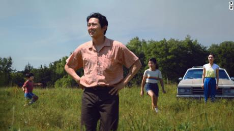 "Steven Yeun (center) is shown in a scene from ""Minari"" with (from left) Alan S. Kim, Noel Cho and Yeri Han."