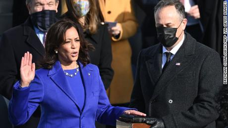 Kamala Harris, flanked by husband Doug Emhoff, is sworn in as the 49th US Vice President on January 20 at the US Capitol in Washington.