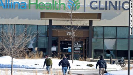 Law enforcement personnel walk toward the Allina Health clinic on Feb. 9, 2021, in Buffalo, Minnesota.