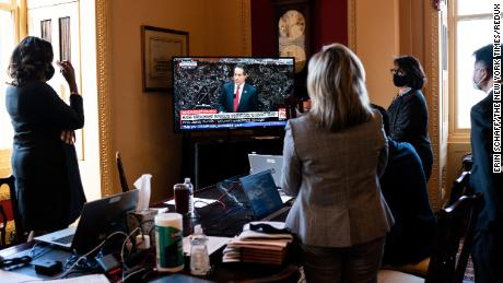 House impeachment managers watch TV as fellow manager Rep. Jamie Raskin (D-Md.) explains what it was like to have his daughter at the Capitol during the January 6 riot, as he addresses the first day of the second Senate impeachment trial of former President Donald Trump in Washington on Tuesday, Feb. 9, 2021. House impeachment managers and Trump's defense team clashed over whether the Constitution allowed the Senate to hold a trial of a former president, ultimately deciding it could move forward. (Erin Schaff/The New York Times)