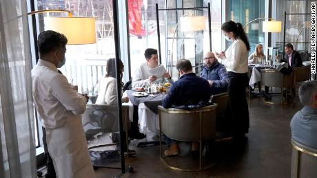 Patrons eat lunch indoors on January 27 at Gibsons Italia restaurant in Chicago.