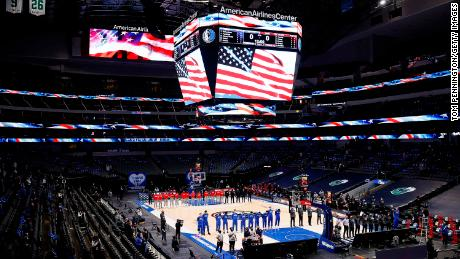 The Mavericks and the Atlanta Hawks stand for the National Anthem prior to tipoff of their NBA game.