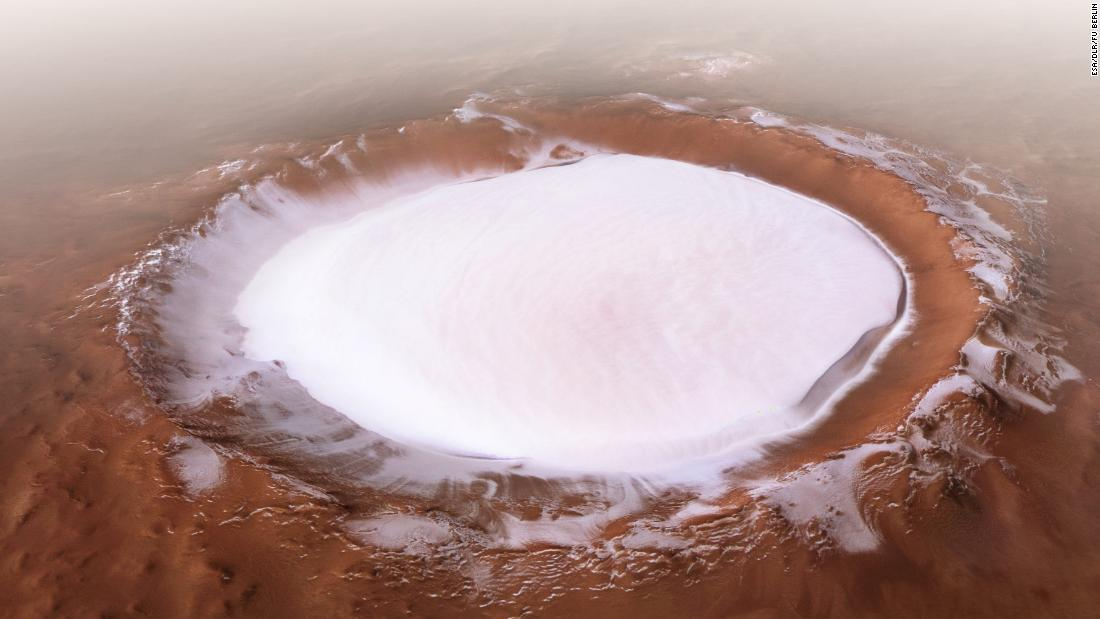 The European Space Agency's Mars Express mission captured this 2018 image of the Korolev crater, より多い 50 miles across and filled with water ice, near the north pole.