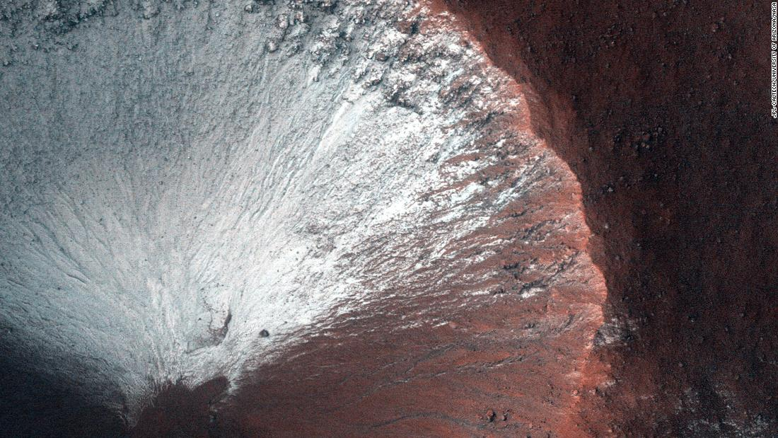 HiRISE took this image of a kilometer-size crater in the southern hemisphere of Mars in June 2014. The crater shows frost on all its south-facing slopes in late winter as Mars is heading into spring.
