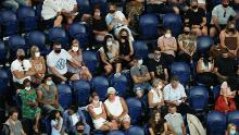Spectators in the crowd watch the Women's Singles second round match between Coco Gauff of the United States and Elina Svitolina of Ukraine during day four of the 2021 Australian Open at Melbourne Park on Thursday.