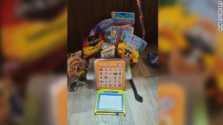 Vincent took her son to a dollar store to pick out items, including a magnetic doodle board and a road sign bingo game, to ease his boredom during her deliveries.