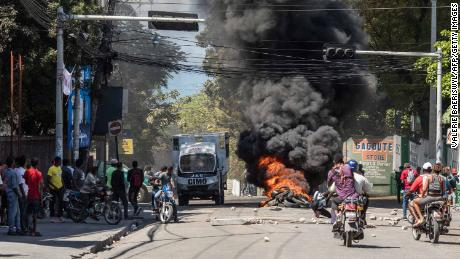 Tires are set ablaze during a march in Port-au-Prince on February 10, 2021, to protest against the government of President Jovenel Moise.