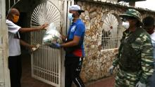 Inhabitants of the Manzanillo sector receive  food bags on April 1, 2020, south of the municipality of San Francisco, Venezuela.