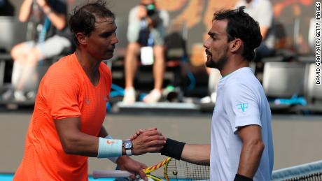 Nadal (left) shakes hands with  Fognini after their men's singles match.