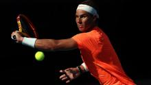 Nadal plays a backhand in his match against Fognini.