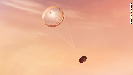 NASA's Perseverance rover deploys a supersonic parachute before landing, in this artist's illustration.