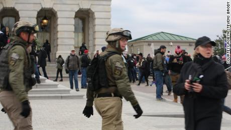 Watkins, center, and Crowl, left, were among alleged Oath Keepers who wore body armor and the group's insignia at the Capitol on January 6.