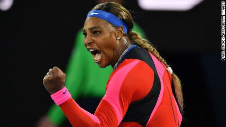 Williams celebrates after winning a point against Halep.