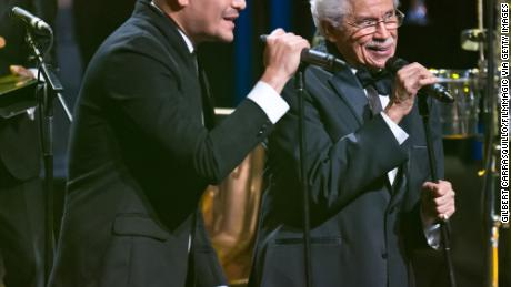 Johnny Pacheco sings with Victor Manuelle at the 22nd ASCAP Latin Music Awards in 2014.